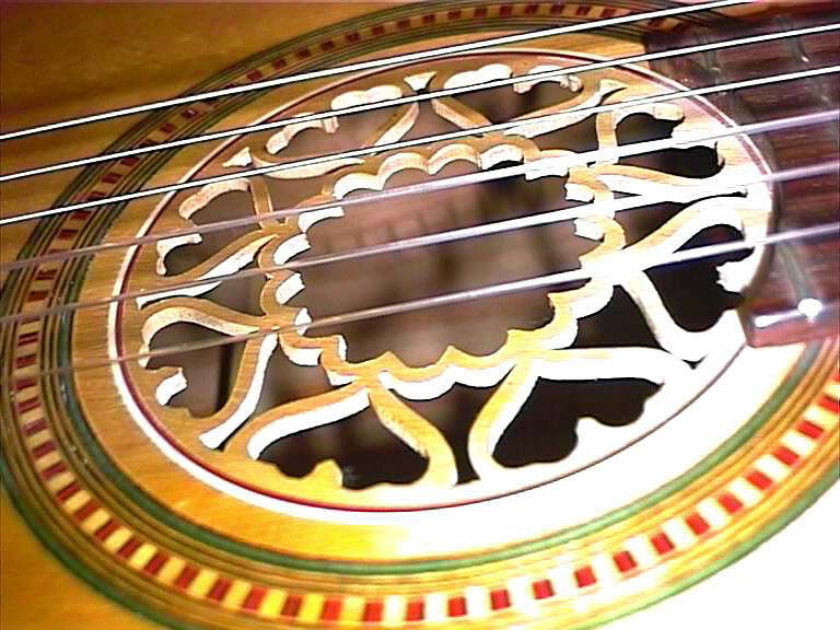Ornate Fretwork enhances the already detailed marquetry